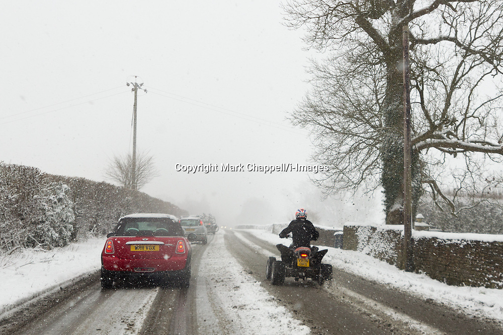 Not all drivers heed police warnings to drive cautiously, as heavy overnight snow causes disruption on the A4 in north Wiltshire between Bath and Chippenham. January 18 2013.  Corsham, UK..Photo by: Mark Chappell/i-Images