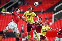 Football - 2020 / 2021 Premier League - Manchester United vs Burnley - Old Trafford<br /> <br /> Chris Wood of Burnley out jumps Harry Maguire of Manchester United for a header on goal at Old Trafford<br /> <br /> Credit COLORSPORT/LYNNE CAMERON