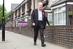 © Licensed to London News Pictures. 23/05/2015. London, UK. Labour Party candidate for Tower Hamlets Mayor, John Biggs canvassing on the Isle of Dogs in Tower Hamlets, east London. The Tower Hamlets Mayoral election will be re-run on 11th June after a High Court election petition found the previously elected mayor, Lutfur Rahman guilty of corrupt and illegal practices. Photo credit : Vickie Flores/LNP