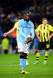 Manchester City's Mario Balotelli smiles after words from Borussia Dortmund's Roman Weidenfeller tried to distract him as he steps up for a last minute penalty - Photo mandatory by-line: Joe Meredith/JMP  - Tel: Mobile:07966 386802 03/10/2012 - Manchester City v Borussia Dortmund - SPORT - FOOTBALL - Champions League -  Manchester   - Etihad Stadium -