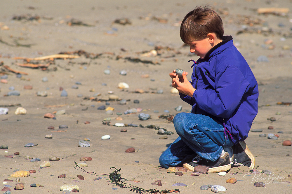 Child (age 7) exploring on Sand Dollar Beach, Big Sur Coast, California
