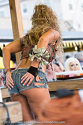 Working the Boothill Saloon on Main Street during Biketoberfest. Daytona Beach, FL, USA. Friday October 20, 2017. Photography ©2017 Michael Lichter.