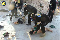 April 4, 2017 - Khan Sheikhoun, Idhib Province, Syria - Syrian Civil Defense aka the White Helmets, helping victims after morning attack of a suspected serious lethal gas (most likely sarin nerve gas), in rebel-held Idlib Province in northwestern Syria, near Turkey (population 165,000). A score wounded and over dozen already dead, others might die shortly as a after effect of exposure to deadly gases. The inhabitants are overwhelmingly Sunni Muslims, although there is a significant Christian minority. (Credit Image: © Syria Civil Defense via ZUMA Wire).