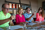 A group of men and women enjoy wine tasting session at Hush Heath Winery, Staplehurst, Kent, England, UK.  (photo by Andrew Aitchison / In pictures via Getty Images)