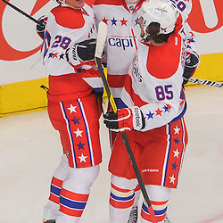Washington Capitals right wing Alexander Semin (28) celebrates his goal with line mates during second period NHL action between the Washington Capitals and the New York Rangers at Madison Square Garden in New York, N.Y.