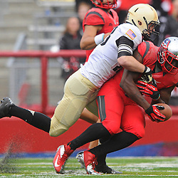 10 November 2012: Rutgers Scarlet Knights wide receiver Mark Harrison (81) makes a reception and is tackled by Army Black Knights linebacker ALex Meier (23) during NCAA college football action between the Rutgers Scarlet Knights and Army Black Knights at High Point Solutions Stadium in Piscataway, N.J..