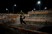 Havana, Cuba. December 2017. A 13-year-old boy, coming from Oriente province, is improvising old Cuban tunes on his trumpet on the roof of Hermanos Ameijeiras Hospital at night in central Havana. He said that most of the young people around him prefer reggaton these days and are not interested his kind of music and that makes him feel quite lonely.