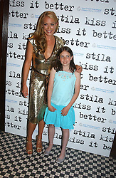 Left to right, CAT DEELEY and KATY VOOS  at a party to promote the Kiss It Better campaign for the Great Ormond Street Hospital in association with Stila and Space.NK held at Frankie's, Yeoman's Row, London on 31st May 2005.<br /><br />NON EXCLUSIVE - WORLD RIGHTS