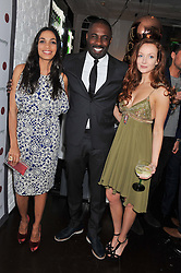 Left to right, ROSARIO DAWSON, IDRIS ELBA and OLIVIA GRANT at the opening of the 'pop up' Tanqueray Gin Palace hosted by Idris Elba at 13 Floral Street, Covent Garden, London on 26th March 2013.