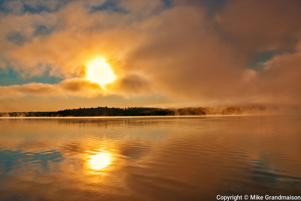 Fog on the Saint John River at sunrise, Near Mactaquac, New Brunswick, Canada