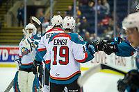 KELOWNA, CANADA - AUGUST 31: Ethan Ernst #19 high fives the bench after assisting a first period goal by Jack Cowell #8 of the Kelowna Rockets against the Victoria Royals  on August 31, 2018 at Prospera Place in Kelowna, British Columbia, Canada.  (Photo by Marissa Baecker/Shoot the Breeze)  *** Local Caption ***