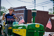 03 JULY 2021 - NORWALK, IOWA: A man drives his antique John Deere tractor through town during the 4th of July parade in Norwalk, Iowa. Last year's parade was cancelled because of the COVID-19 pandemic. Norwalk is an agricultural community south of Des Moines. In recent years, Norwalk has become a suburb of Des Moines.        PHOTO BY JACK KURTZ
