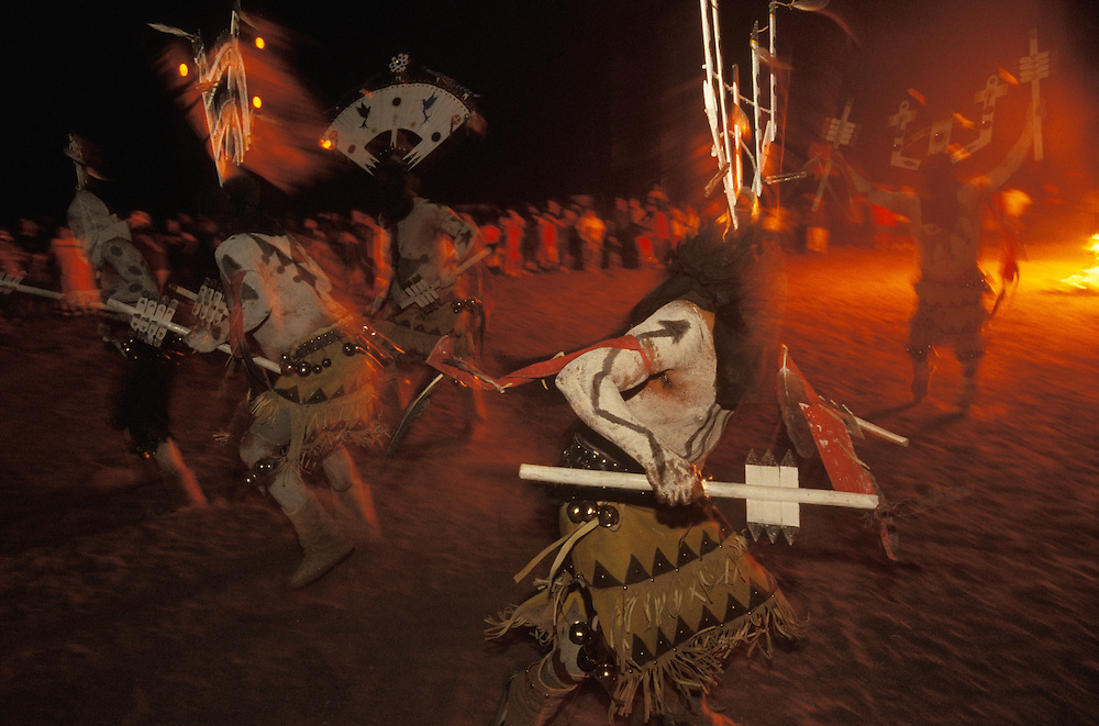 Mountain Spirits (Gaan) or Crown Dancers dance beside a big bonfire at night during an Apache Sunrise Dance, a first menstruation rite, on the San Carlos Apache Indian Reservation in Arizona, USA. The Sunrise Dance is the most important ceremony of the Apache Indians. It is held during the summer, within one year after the girl has had her first menstruation, and lasts for four days. The rites are supposed to prepare the girl for adulthood and to give her a long and healthy life without material wants.