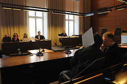 Germany, Freiburg - May 13, 2019.The sencond day of the trial against Bernhard Haase for the case of the missing German girl Maria H. / Bernhard Haase hides his face behind a folder, Freiburg court May 13, 2019.In front of him Maria H. and her mother.The case of the missing German girl Maria H. 13 Italian police has arrested Bernhard Haase 58. The 2 lived almost 5 years in Licata despite the man (Bernhard Haase) was wanted by the international police. They were lovers but they had declared themselves as father and daughter in the town of Licata / Sicily (Credit Image: © Antonio Pisacreta/Ropi via ZUMA Press)