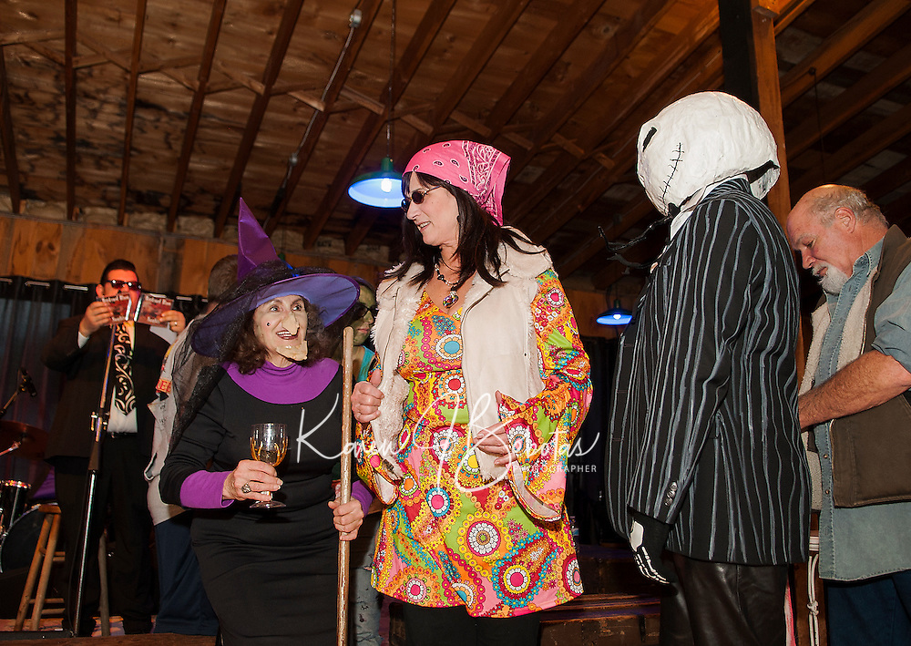 "Donna Hermle as a witch, Mary Jane Cooney from the 60's and Leighton Bates as Jack Skellington with Mr. Nick's Blues Mafia on stage during the ""Monster Ball"" for Pitman's Freight Room on Sunday afternoon.  (Karen Bobotas/for the Laconia Daily Sun)"