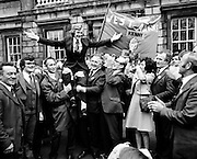 Newly Elected T. D. Enda Kenny Arrived at The Dail. Following the death of his father, Henry Kenny T. D., Enda Kenny was proposed by the Fine Gael Party to contest the seat. He was duly elected and went to Dublin to take up his seat in Dail Eireann at Leinster House, Dublin. Image of Enda Kenny being held aloft by supporters, many of whom had travelled by bus from Mayo to attend his first day as a T.D.<br /> <br /> 18/11/1975<br /> <br /> 18th November 1975