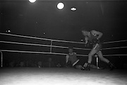 25/01/1963<br /> 01/25/1963<br /> 25 January 1963<br /> National Junior Boxing Championships at the National Stadium, Dublin. Picture shows W. Turkington of Doagh Boxing Club knocking down P. Gaule of Kilkenny in the Light/Welterweight final.