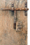 old rusty metal bold on wooden door
