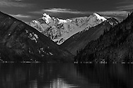 Chilliwack lake and Mount Redoubt photographed from Chilliwack Lake in Chilliwack Lake Provincial Park in British Columbial, Canada.  Mount Redoubt and Nodbout Peak are in North Cascades National Park in Washington State.