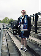 A loyal fan, Terry Scott bangs the drum for Margate FC dressed as an old lady and self titled the 'Margate Banshee'. Dulwich Hamlet FC V Margate for the last game of the season at DHFC temporary ground at Imperial Fields on 28th April 2018 in Mitcham, South London in the United Kingdom. Dulwich Hamlet was founded in 1893 and both teams play in the Isthmian League Premier Division, a regional mens football league covering London, East and South East England.