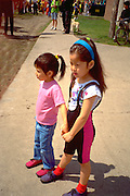 American Indian sisters age 4 and 6. In the Heart of the Beast May Day Festival and Parade Minneapolis  Minnesota USA