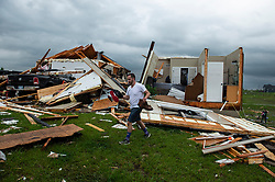 Tanner Beam, Lenexa, helps carry belongings from a home hit by a tornado Tuesday, May 29, 2019 west of Bonner Springs, Kansas. The home belonged to Travis and Kay Boatwright who rode out the storm with their 14-year-old son Jacob in the basement. They escaped unharmed. Photo byChris Ochsner/Kansas City Star/TNS/ABACAPRESS.COM