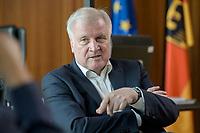 01 JUL 2019, BERLIN/GERMANY:<br /> Horst Seehofer, CSU, Bundesinnenminister, waehrend einem Interview, in seinem Buero, Bundesministerium des Inneren<br /> IMAGE: 20190701-01-046<br /> KEYWORDS: Büro