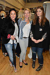 Left to right, M.E.MARTONE, FIONA CURTIS and STEPHANIA KALLOS at the launch of 'Your Hormone Doctor' a book by Leah Hardy, Susie Rogers and Dr Daniel Sister held at The Library, 206-208 Kensington Park Road, London W11 on 8thMay 2014.