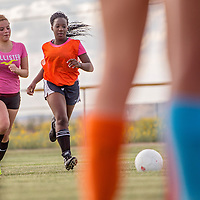 081413       Cable Hoover<br /> <br /> Frida Ceniceros, left, and Sephora Koffi run drills during Gallup Bengals girls soccer practice Wednesday at Gallup High School.