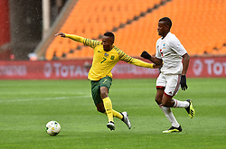 South Africa: Johannesburg: Bafana Bafana player Lebohang Maboe battle for the ball with Seychelles player Benoit Marie during the Africa Cup Of Nations qualifiers at FNB stadium, Gauteng.<br />Picture: Itumeleng English/African News Agency (ANA)