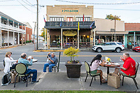 With the gradual easing of Louisiana's stay at home order Café Sydnie Mae customers dine Saturday, May 4, 2020 at several outdoor tables along the sidewalks of downtown Breaux Bridge, La.