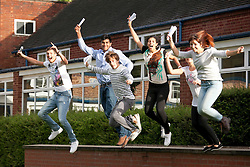 © Licensed to London News Pictures.16/08/2012. Solihull, West Midlands. Pupils at Solihull School celebrating their A level results. Pictured, jumping for joy, 18, A, A levels between them, Sam Weighall, Usama Wallis, Helen-Cara Younan, Kara Abdou, Sasha Mascord.  Photo credit : Dave Warren/LNP