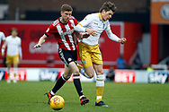 Chris Mepham of Brentford (L) barges Adam Reach of Sheffield Wednesday (R) off the ball. EFL Skybet football league championship match, Brentford v Sheffield Wednesday at Griffin Park in London on Saturday 30th December 2017.<br /> pic by Steffan Bowen, Andrew Orchard sports photography.