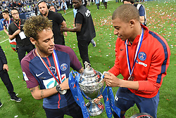 Paris Saint-Germain's Brazilian forwar Neymar Jr celebrates with the trophy with Kylian Mbappe at the end of the French Cup final football match between Les Herbiers and Paris Saint-Germain (PSG), on May 8, 2018 at the Stade de France in Saint-Denis, outside Paris, France. Photo by Christian Liewig/ABACAPRESS.COM