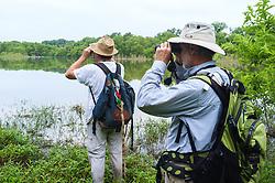 Hikers exploring pond near Piedmont Ridge Great Trinity Forest, Dallas, Texas, USA