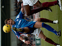 Photo: Ian Hebden.<br />Northampton Town v Rushden & Diamonds. Coca Cola League 2. 04/02/2006.<br />Rushden's Drew Broughton hooks the ball forward.
