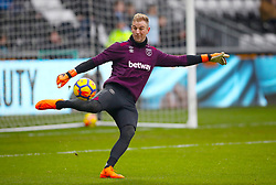 West Ham United goalkeeper Joe Hart warms up ahead of the Premier League match at the Liberty Stadium, Swansea.