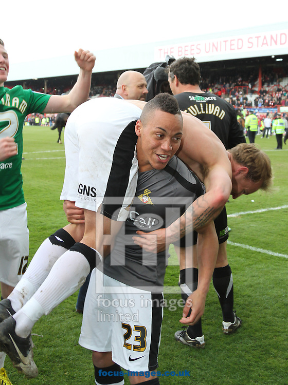 Picture by David Horn/Focus Images Ltd +44 7545 970036.27/04/2013.Kyle Bennett of Doncaster Rovers celebrates the victory with goalscorer James Coppinger after the npower League 1 match at Griffin Park, London.
