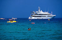 A yaght and swimmers off Tahiti Beach in St. Tropez, on the Cote d'Azur of the French Riviera-photograph by Owen Franken