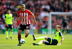 Southampton's Oriol Romeu gets away from Huddersfield Town's Jon Gorenic Stankovic during the Premier League match at St Mary's Stadium, Southampton.