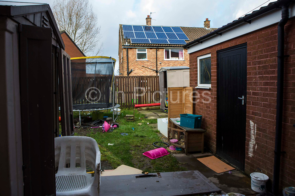 The family garden of a council house on an estate in Leyland, Lancashire.