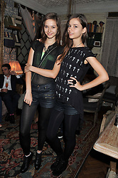Left to right, sisters ANNA KUPRIENKO and SONYA KUPRIENKO at an afternoon tea party in aid of the Naked Heart Foundation held at Mari Vanna, Wellington Court, 116 Knightsbridge, London on 29th August 2012.