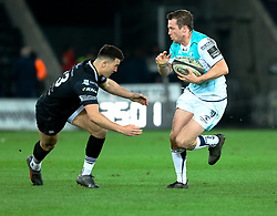 Connacht's Jack Carty under pressure from Ospreys' Owen Watkin<br /> <br /> Photographer Simon King/Replay Images<br /> <br /> Guinness PRO14 Round 19 - Ospreys v Connacht - Friday 6th April 2018 - Liberty Stadium - Swansea<br /> <br /> World Copyright © Replay Images . All rights reserved. info@replayimages.co.uk - http://replayimages.co.uk