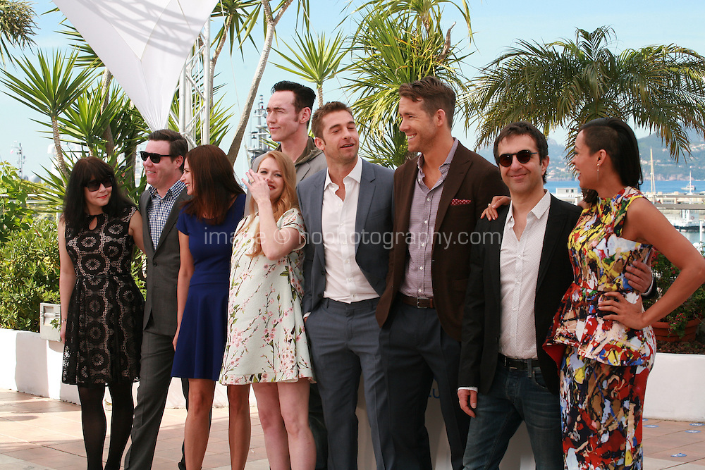 Simone Urdl, Stephen Traynor, Jennifer Weiss, Kevin Durand, Mireille Enos, Scott Speedman, Ryan Reynolds, Atom Egoyan and Rosario Dawson at the photocall for the film Captives at the 67th Cannes Film Festival, Friday 16th May 2014, Cannes, France.