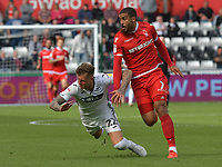Football - 2018 / 2019 Sky Bet EFL Championship - Swansea City vs. Nottingham Forest<br /> <br /> Joe Rodon of Swansea City & Lewis Grabban of Nottingham Forest collide , at Liberty Stadium.<br /> <br /> COLORSPORT/WINSTON BYNORTH