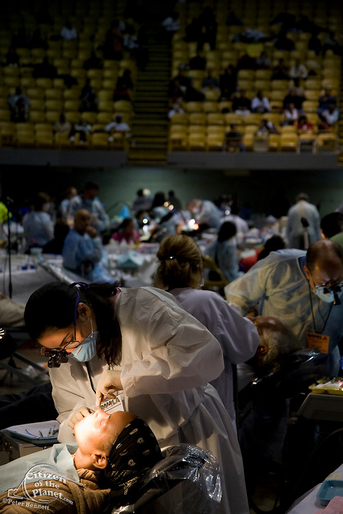 Dentist work on patients. Free Medical care at the Los Angeles Forum. Remote Area Medical Volunteer Corps (RAM) is a Knoxville, Tennessee-based, non-profit, volunteer, medical relief corps that provides free health to people in the Un<br /> ited States and third world countries. Inglewood, Los Angeles, California ,USA
