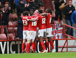 Charlton Athletic's Dorian Dervite is mobbed by team after scoring his sides winning goal - Photo mandatory by-line: Robin White/JMP - Tel: Mobile: 07966 386802 18/03/2014 - SPORT - FOOTBALL - The Valley - Charlton - Charlton Athletic v Bournemouth - Sky Bet Championship