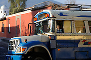 An early morning bus traveling through the network of one way streets in Antigua. Antigua Guatemala, Republic of Guatemala. 03Mar14