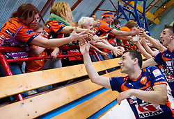 Andrej Flajs of ACH celebrates with fans after winning the volleyball match between Calcit Volleyball and ACH Volley in 4th Final Round of Radenska Classic League 2012/13 on April 16, 2013 in Arena Kamnik, Slovenia. ACH Volley defeated Calcit Kamnik in games 3-1 and became Slovenian National Champion 2013.(Photo By Vid Ponikvar / Sportida)