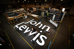 © Licensed to London News Pictures. File picture taken 21/07/2016. A John Lewis shop sign being manufactured at the Omega Signs factory in Leeds. John Lewis has confirmed another eight stores will close permanently putting 1,465 jobs at risk. The retail giant has announced it plans to close shops in Kent, Yorkshire, Aberdeen, Cheshire, Hampshire and Northamptonshire. In January the group recorded its first loss in its 157-year history, after announcing that eight stores were closing last July. Photo credit: Andrew McCaren/LNP
